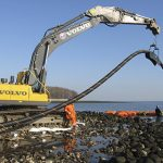 Large Crane Holding Cable for Underwater Installation Near Long Island, NY