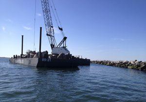Marine Construction Equipment Working on Brake Wall